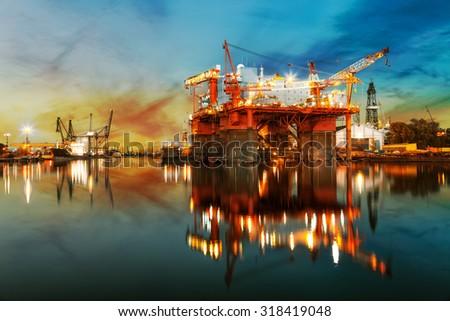 Ship under construction in shipyard at sunrise. - stock photo