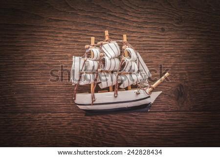 ship vessel boat craft battleship frigate sail marine memory recollection reminiscence remembrance flashback commemoration wooden floor - stock photo