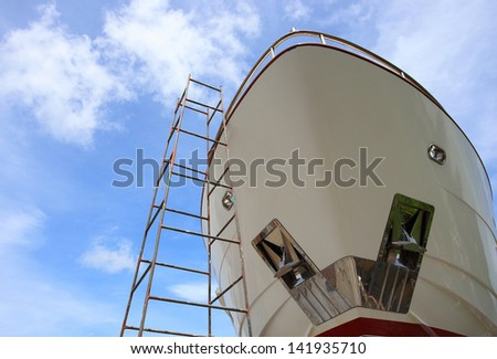 Ship waiting for repairs in shipyard - stock photo