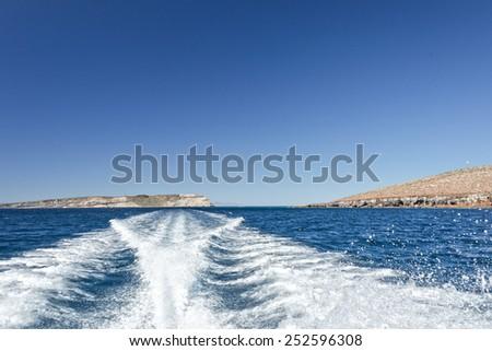 ship wake in pacific ocean - stock photo