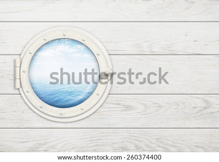 ship window or porthole on white wooden wall with sea or ocean horizon - stock photo