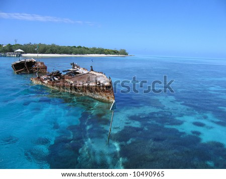 Ship wreck in crystal clear waters of Heron Island - stock photo