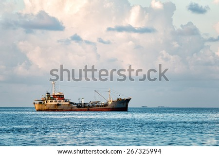 ship wreck in maldives sand reef - stock photo