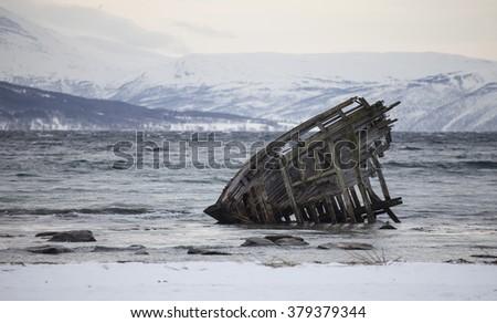 Ship Wreck in Norwegian fjord. - stock photo