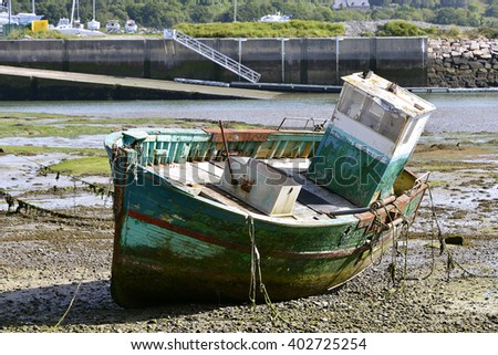Ship wreck in the harbor of Paimpol, a commune in the Cotes of Armor department in Brittany in northwestern France - stock photo