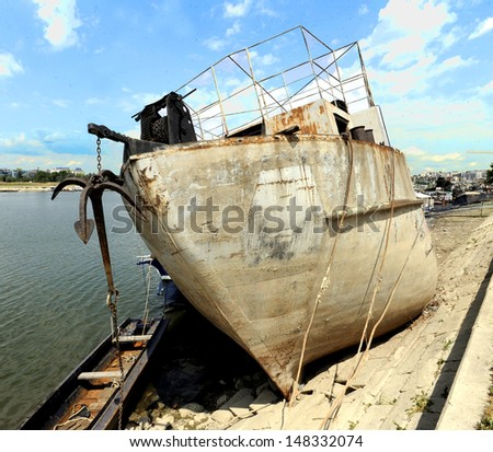 ship wreckage sunked on river bank - stock photo