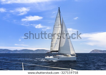Ship yachts with white sails in the Sea. Sailing yacht race. Luxury boats. - stock photo