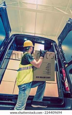 Shipment Van Delivery. Men Reloading Cargo From the Van. Shipping and Logistic Theme. - stock photo