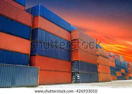 Shipping containers at docks in sunset - stock photo