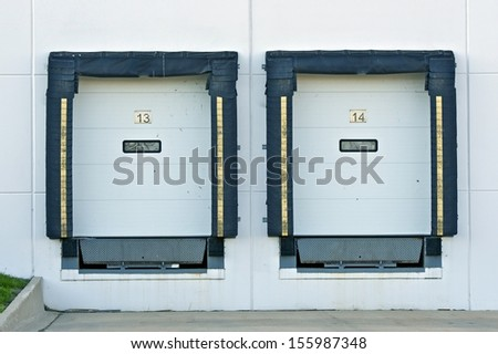 Shipping Gates - Warehouse Building. Two Gates Closeup. Business Collection. - stock photo