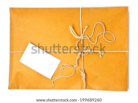 shipping parcel tied with twine and a blank shipping tag for copy space - stock photo