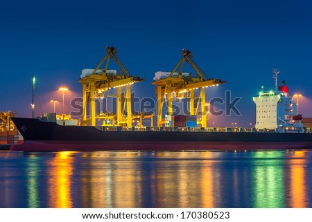 Shipping port with crane for container uploading