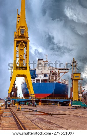 Ships and cranes in shipyard of Gdansk, Poland.