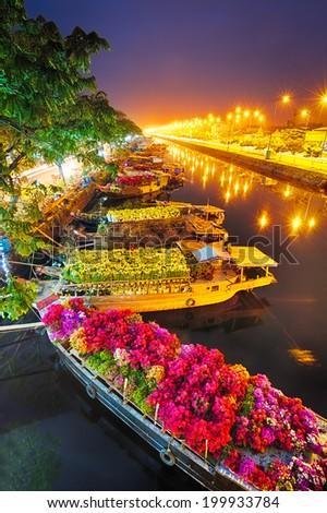 Ships at Saigon Flower Market at Tet, Vietnam - stock photo