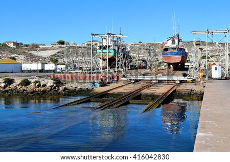 Ships being repaired in a dry dock in a harbor or port. - stock photo