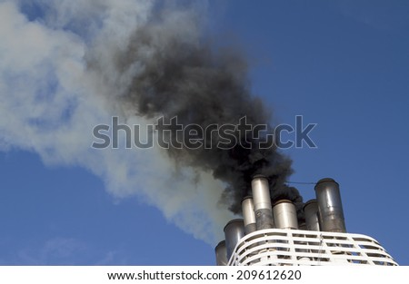 Ships funnel emitting black smoke - stock photo