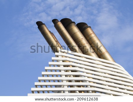Ships funnels with blue sky background - stock photo