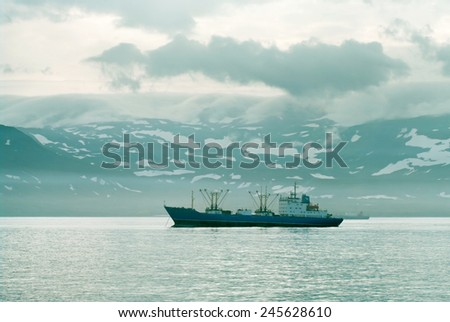 ships in the harbor of island Paramushir,  Kuril Islands, Russia  - stock photo