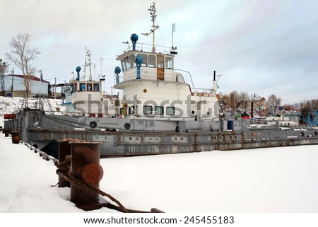 ships in the river port in winter