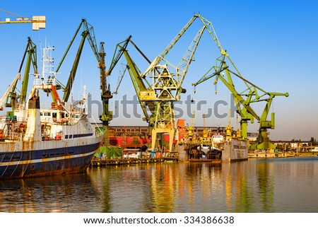 Ships moored at the quay in shipyard of Gdansk, Poland. - stock photo