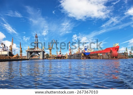 Ships on dock and oil rig in shipyard of Gdansk, Poland. - stock photo
