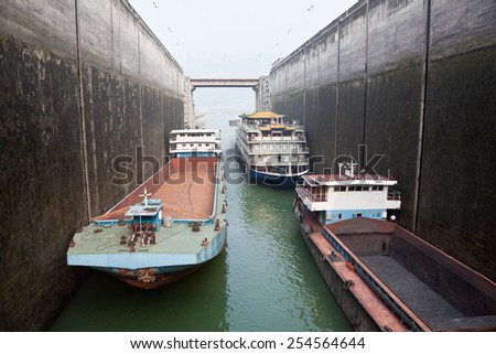 Ships rising in the lock at Three Gorges Dam, China - stock photo