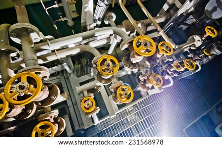 Ships valves, main engine - engineering interior  - stock photo