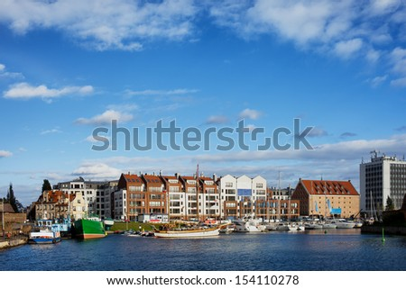 Ships, yachts and apartment buildings in the city of Gdansk, Poland. Marina on the Motlawa river.