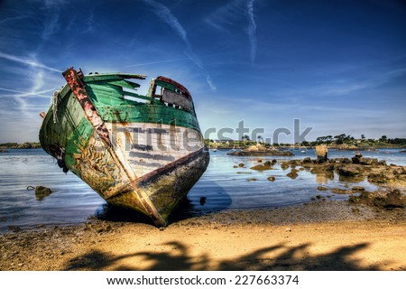 Shipwreck on a Beach in Brittany - stock photo