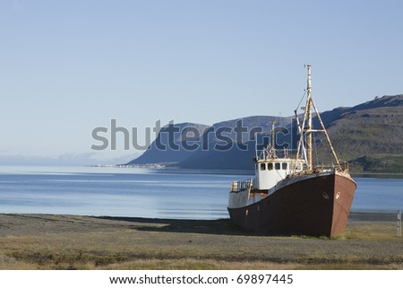 Shipwreck shore beach trawler in Westfjords Iceland - stock photo
