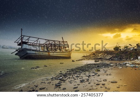 Shipwrecks at sunset while the rain is falling