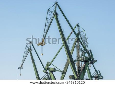 Shipyard cranes also called portal cranes in Gdansk, Poland - stock photo