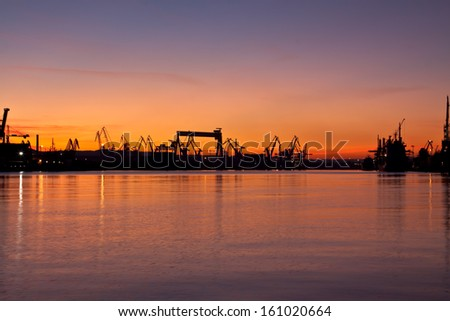 shipyard Gdynia. Poland. Sunset in shipyard.  - stock photo