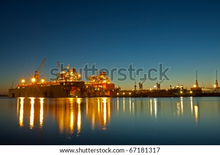 Shipyard in riga at sunset time - stock photo
