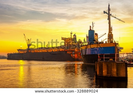 Shipyard in the morning light on Gdansk, Poland. - stock photo