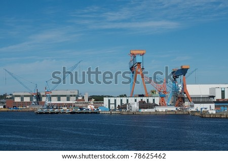 shipyard of Kiel, Germany, with cranes and submarine - stock photo