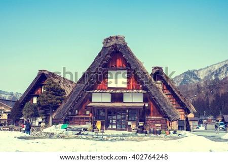 shirakawago village cottage in japan in winter season.vintage color - stock photo