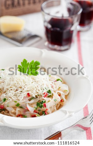 Shirataki noodles with anchovies, chilli, garlic and grated cheese. Selective focus - stock photo