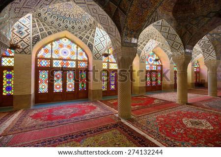 SHIRAZ - APRIL 15: interior of Nasir al-Mulk Mosque (Pink Mosque) in Shiraz, Iran on April 15, 2015. This mosque was built between 1876 and 1888, during the Qajar Dynasty in Shiraz, Iran. - stock photo