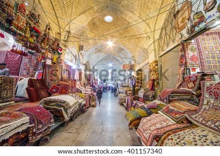Shiraz, Iran - December 24, 2015: Traditional iranian carpets shop in Vakil Bazaar, Shiraz, Iran. Vakil Bazaar is the most important tourist attraction in Shiraz, Iran. - stock photo