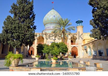 SHIRAZ, IRAN � OCTOBER 8: Ali Ebn-e Hamze Shrine on October 8, 2013 in Shiraz, Iran. Ali Ebn-e Hamze Shrine stands as the tomb of Emir Ali, a nephew of Shah Cheragh. - stock photo