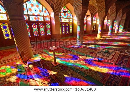 SHIRAZ, IRAN - OCTOBER 9: Nasir-al-Molk Mosque on October 9, 2013 in Shiraz, Iran. Nasir-al-Molk Mosque was built between 1871-1883 by order of Haj Hassan Ali Khan-e-Nasir -al-Molk. - stock photo