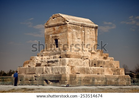 SHIRAZ, IRAN - SEPTEMBER 17: A tourist visiting Tomb of Cyrus the Great on Sep. 17, 2014 in Shiraz, Iran.  Cyrus is the founder of Achaemenid Empire and his tomb area is a UNESCO World Heritage Site. - stock photo