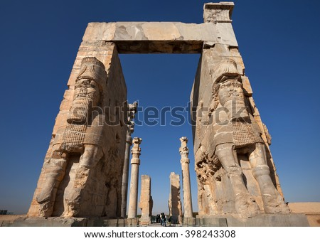 SHIRAZ, IRAN â?? SEPTEMBER 17, 2014: People passing through Gate of All Nations in Persepolis ancient city. construction of this city began at 518 BC under rule of King Darius from Achaemenid dynasty. - stock photo