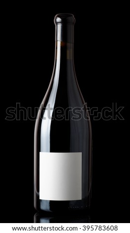 Shiraz red wine in Burgundy style bottle, isolated on black - stock photo