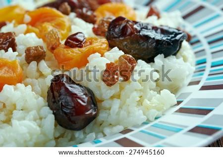 shirin pilaf - sweet pilaf  with dried apricots, raisins and dates. Azerbaijan cuisine - stock photo
