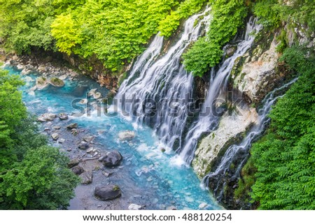 Shirogane waterfall with blue stream at Biei, Japan