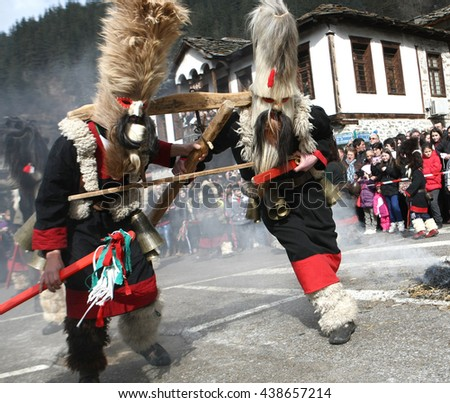 Shiroka laka, Bulgaria - March 1, 2015: Unidentified man in traditional Kukeri costume are seen at the Festival of the Masquerade Games Pesponedelnik in Shiroka laka, Bulgaria.