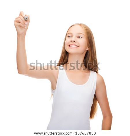 shirt design concept - smiling teenage girl in blank white shirt drawing or writing something in the air - stock photo