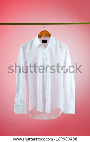Shirt hanging on the hanger - stock photo